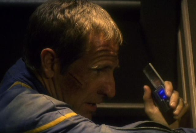 File:Starfleet communicator, 2150s, in use.jpg