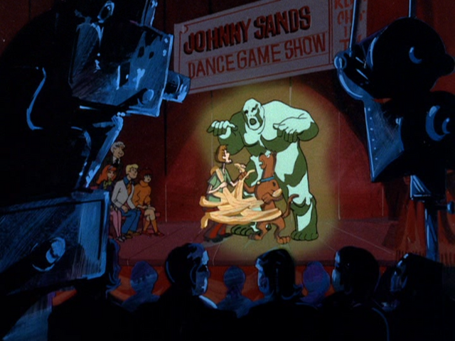 File:Wax Phantom appears at the dance game show.png