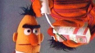 Ernie drinks milk on the ceiling