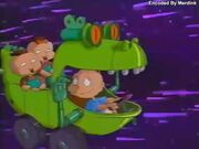 The Rugrats riding in a Reptar car