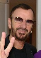 Ringo Starr and a fan backstage in Hamburg, July 2011a