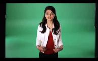 Selena waring a red tank top