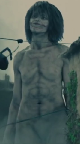 File:Smiling Titan live-action.png