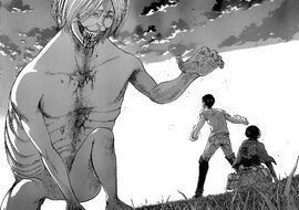 The Smiling Titan reaches for Eren and Mikasa