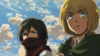 Armin and Mikasa listen to Hannes