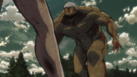 The Armored Titan charges Eren