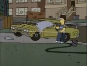 Homer cleaning 70s sports car