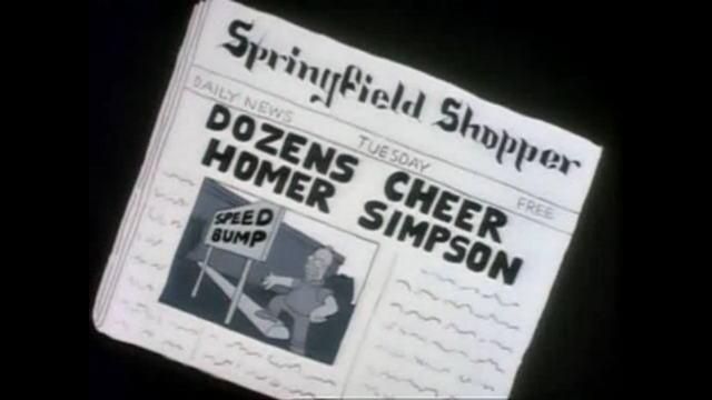 File:HomerNewspaperSpeedBumb.png