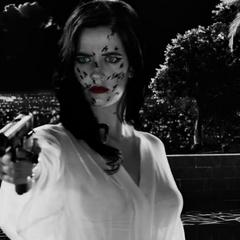 Ava aims the gun at Dwight.