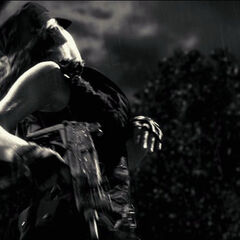 One of the mercenaries dies with her Uzi in hand.