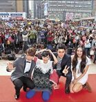 The cast with the fans