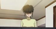 Kyoko looking at the tv