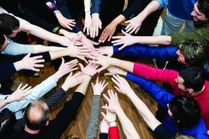 File:Istock business team hands group (300 x 200) teambuilding.jpg