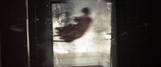 File:Man-of-Steel-Trailer-Images-Superman-Knocked-through-Bank-Door.jpg