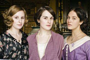 Downton-Abbey-L-R-Edith-Laura-Carmichael-Mary-Michelle-Dockery-Sybil-Jessica-Brown-Findlay-Crawley-DA.0583 resize