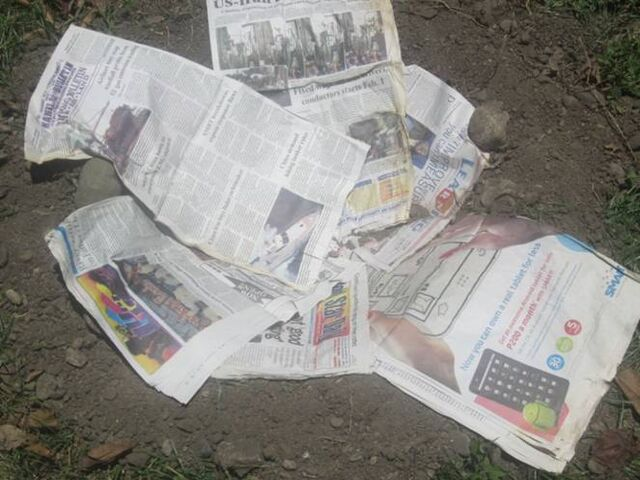 File:Cover with newspaper.jpg