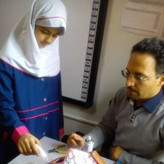 Amir with a student