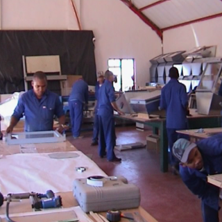 Fabricating the LAZOLA 2 in the workshop. <i>Photo credit: Calitzdorp Solar Cookers</i>