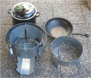Ben 3 with tripod of round steel and stove shells for pot and pan