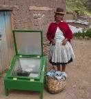 File:CECAM participant with solar oven.jpg