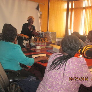 Mama solar facilitating on the use of fireless cooker and solar cookers during training of Alliance of Women in coffee in Nairobi