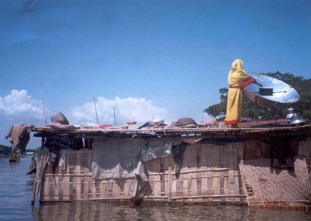 File:Bangladeshi woman cooking in flood 1998.JPG