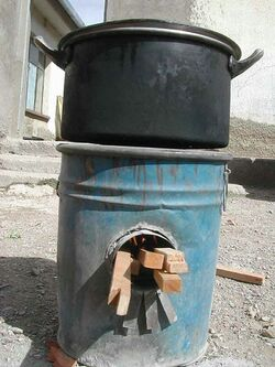 Rocket stove made from barrel in Bolivia