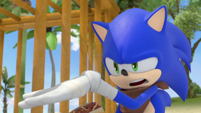 File:Sonic next to a cage.png