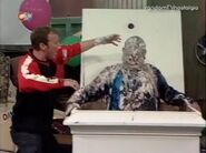 Richard lifts gunged matthew up from cake