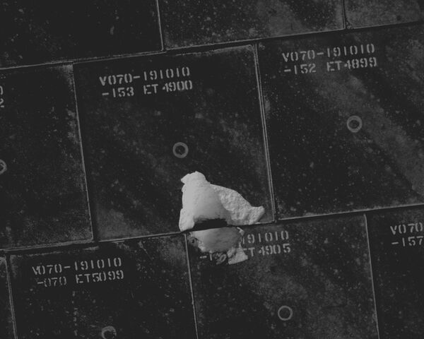 File:Damaged TPS Tiles of Endeavour (NASA S118-E-06229).jpg
