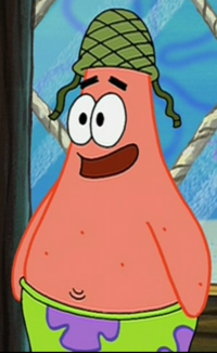 Patrick Wearing an Army Hat