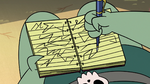S2E20 Buff Frog writing down his final notes