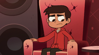 S2E19 Marco Diaz sitting in the lounge throne