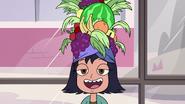 S2E32 Janna wearing a fruit hat