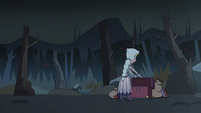 S3E1 Queen Moon looks inside her luggage