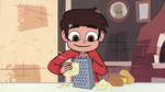 S2E24 Marco Diaz grating cheese with a grater