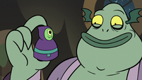S3E5 Buff Frog holding babushka monster game piece