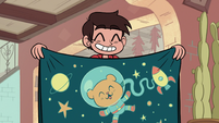 S1E9 Marco holding a space blanket
