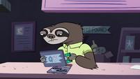 S2E18 Sloth employee swiping the gift card