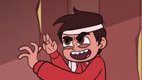 S1E3 Marco wearing a headband