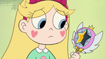 S2E23 Star Butterfly looking at her wand
