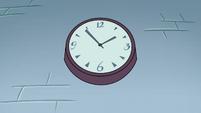 S2E32 Clock on the classroom wall