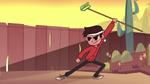 S1E3 Marco wielding a rake