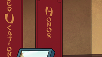 S2E37 Dojo banner with 'Honor' written on it