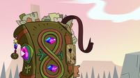 S3E3 Book of Spells wagging its ribbon at Ludo