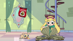 S2E25 Star Butterfly continues flipping through the book