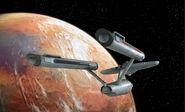 USS Enterprise orbits M-113