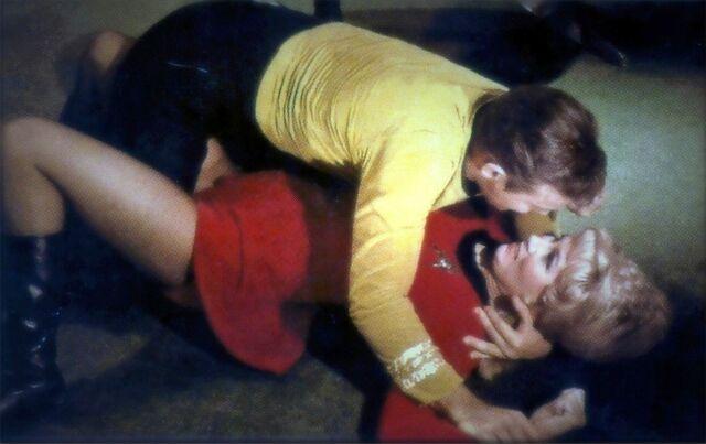 File:Rand pinned to floor by Animal Kirk.jpg