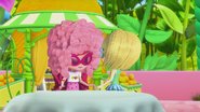 Lemon is giving Strawberry a wig and glasses