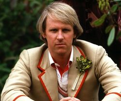 Peter-davidson-fifth-doctor-celery-in-his-pocket-and-a-frown-on-his-face